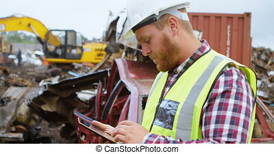 Male worker using digital tablet in the junkyard 4k