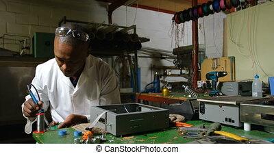 Male worker using soldering iron in glass factory 4k - Male ...