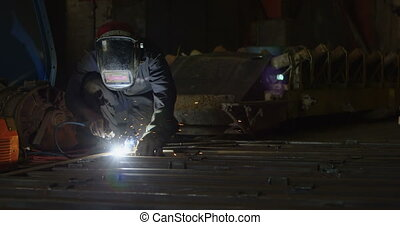 Male worker using welding torch in the workshop 4k -...