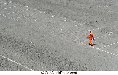 Male worker walking on the road