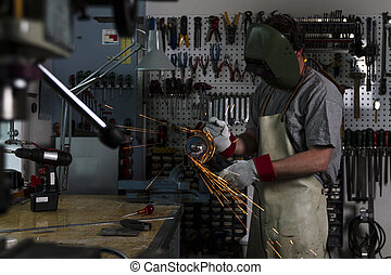 Male worker with his tool.