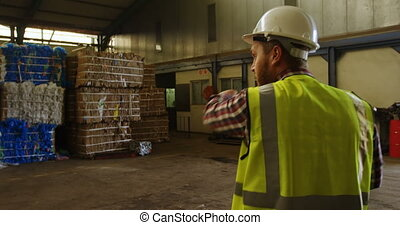 Male worker working in warehouse 4k - Rear view of male...