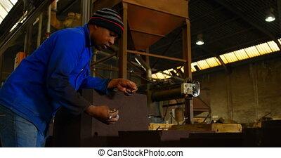 Male worker working in workshop 4k