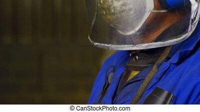 Male worker working in workshop 4k - Male worker working in ...
