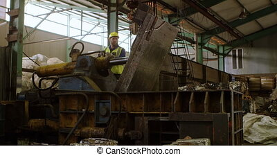 Male worker working on machine in warehouse 4k