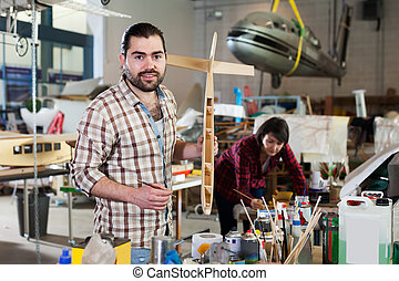 Male working on creating of airplane models