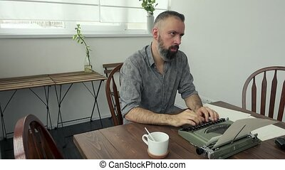 Male writer looking for inspiration and typiing