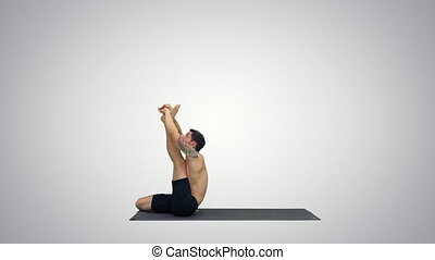 Male yoga teacher in heron pose Intense hamstring stretch...