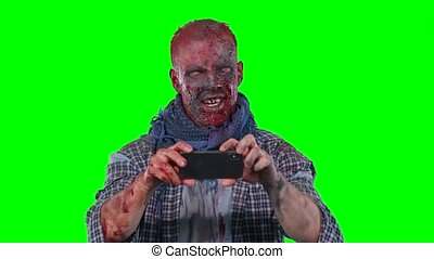 Male zombie using cell phone