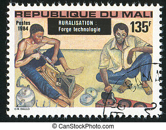 Metal workers - MALI CIRCA 1984: stamp printed by Mali,...