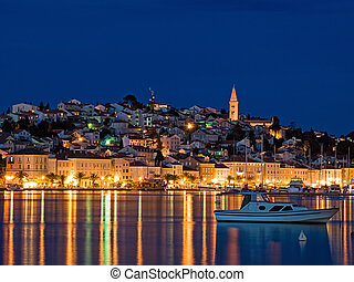 Evening View of the largest city on the island Losinj, Croatia. Long blend exposure.