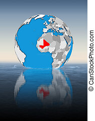 Mali on globe in water