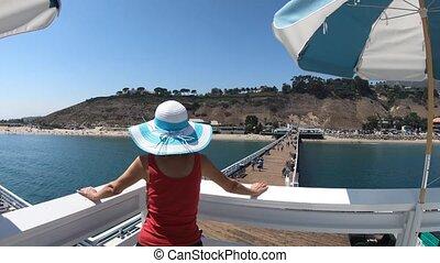 Malibu Pier Woman - Caucasian woman at Malibu Pier in...