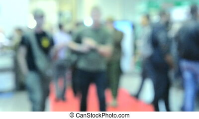 Blurred Background flow of many people inside space shopping center