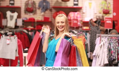 Mall defile - Attractive blonde woman being happy with her...