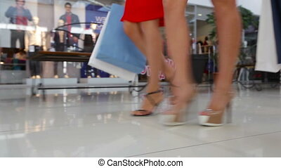 Mall march - Close-up of shopping girls marching in the mall