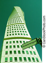 MALMO, SWEDEN - APRIL 9, 2013: Turning Torso skyscraper on aPRIL 8, 2013 in Malmo, Sweden. Designed by Santiago Calatrava, it is the most recognized landmark of Malmo and Sweden today.