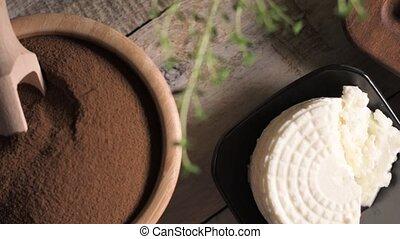 Malt loaf bread flour powder and creamy cheese on rustic...