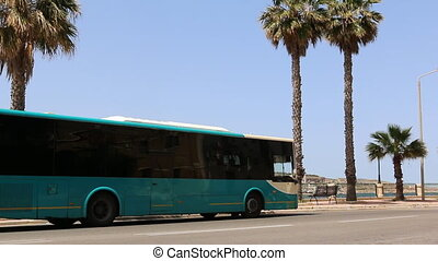 Malta bus - Public transport bus stopped at the bus stop to...