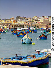Malta Fishing Harbour - Traditional Malta boats moored at...