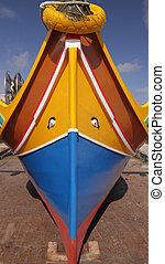 maltese traditional colorful fishing boat , Marsaxlokk, Malta