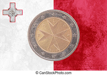 Maltese two euros coin with flag of Malta as background