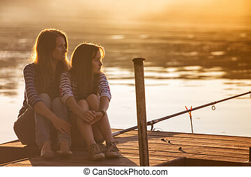 mama with daughter - Mama with teen daughter sitting on the ...
