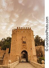 Mammatus clouds over Alcantara Bridge in Toledo. Toledo,...