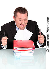 Man about to devour a pile of files