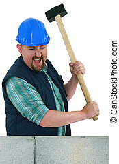 Man about to smash a wall using a mallet