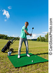Man about to strike golf ball