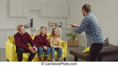 Man acting out a word in the game of charades