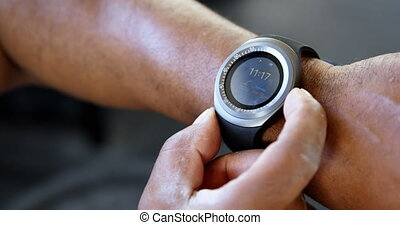 Man adjusting his smart watch 4k - Close-up of man adjusting...