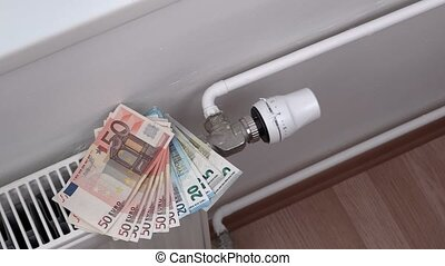 Man adjusting radiator and take money
