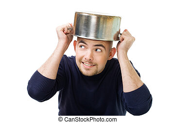 Man afraid and protecting his head holding casserole, isolated on white