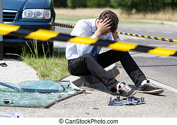 Man after car accident - Horizontal view of man after car...