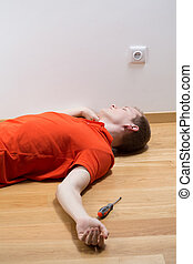 Man after electrocution - Young unconscious man lying on...