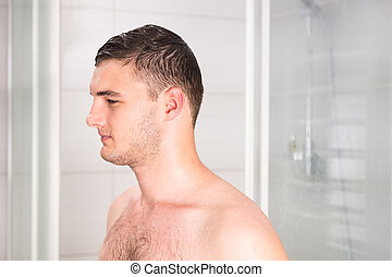 Man after shower standing in the bathroom