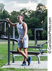Man after training in a park