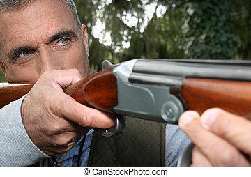 Man aiming a rifle