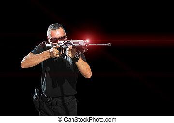Man aiming assault rifle laser sight
