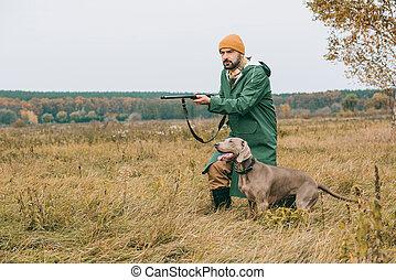 man aiming at something with gun