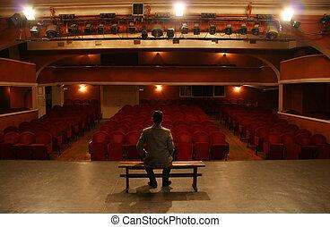 man alone on theater scene