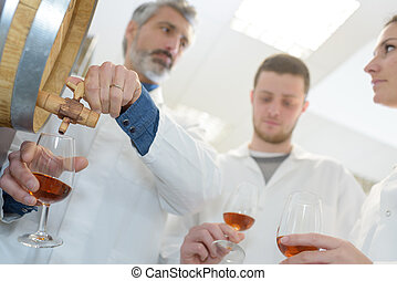 man an students tasting wine