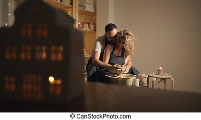man and a woman making clay jug on potter's wheel, 4k