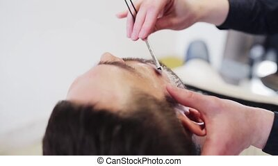 man and barber with straight razor shaving beard - beauty,...