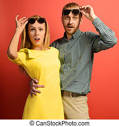man and beautiful slender young woman in a yellow dress with glasses