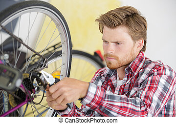 man and bike tire