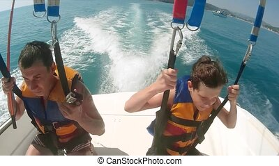 man and boy paragliding lifestyle and parasailing. are...