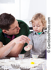 Man and boy playing in kitchen